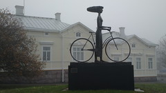 Foggy bicycle statue Wind From The Sea by  Rafael Saifulin, given by Helkama on their centenary (hugovk) Tags: cameraphone from november autumn sea bicycle statue by finland nokia wind foggy hanko rafael their hvk given syksy the centenary carlzeiss 808 southernfinland 2013 helkama hugovk geo:country=finland camera:Make=nokia exif:Focal_Length=80mm exif:ISO_Speed=64 saifulin pureview exif:Flash=offdidnotfire exif:Aperture=24 nokia808pureview exif:Orientation=horizontalnormal exif:Exposure=1313 camera:Model=808pureview exif:Exposure_Bias=0 uudenmaanmaakunta geo:county=uudenmaanmaakunta geo:region=southernfinland geo:locality=hanko foggybicyclestatuewindfromtheseabyrafaelsaifulingivenbyhelkamaontheircentenary meta:exif=1383682919