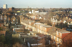 Suburban sunshine. (Trapac) Tags: city uk homes windows roof england urban panorama brick london gardens back spring nikon cityscape suburban terrace townhouse bricks rear terraces suburbia full housing suburbs backs elevated rearview nikkor crowding distance overlooking outskirts roofing crowded distant townhouses dense garages actontown wmh northacton londonbrick nikkor3570mm 2013 d700 nikond700 flickrcollectionongetty tracypackerphotography wwwtracypackercom gettymomentcreativecollection