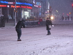 People taking pictures in the snow in Times Square, New York City, USA during winter snow storm, where the New Years Eve ball is dropped (RYANISLAND) Tags: nyc newyorkcity usa snow ny newyork storm cold weather america 14 snowstorm freezing american timessquare snowing storms wintersnow coldweather northeast extremeweather winterstorm noreaster winterweather 2014 snowstorms weatherstorm winterstormhercules