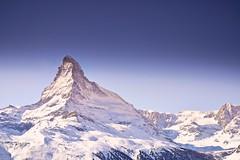 Matterhorn - Zermatt (Captures.ch) Tags: blue trees sky orange white snow mountains green yellow schweiz switzerland swiss gray unesco zermatt matterhorn wallis swissmountains vallais {vision}:{outdoor}=099 {vision}:{mountain}=0508 {vision}:{sunset}=0625 {vision}:{sky}=097 {vision}:{clouds}=0971 {vision}:{ocean}=0638