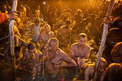 During Kumbh Mela pilgrimage 2013, Allahabad, India (David Ducoin) Tags: portrait india water night river bath asia indian police happiness ritual bathing pilgrimage pilgrim ganga mela allahabad purification menonly kumbhmela kumbh 2013 davidducoin vision:outdoor=051 vision:sky=0662
