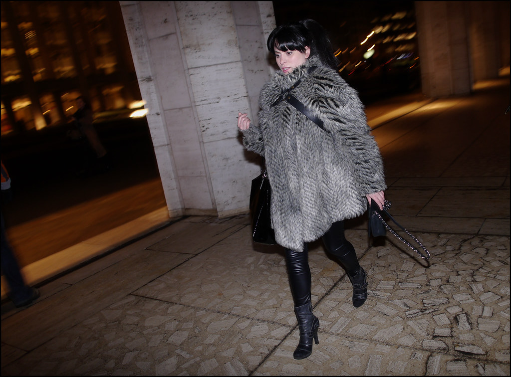FW 2014-2 -31 w grey fur with leather shoulder harness over black leggings over ankle heeled boots ol