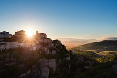 Another Gordes Sunrise (Philipp Klinger Photography) Tags: morning blue autumn light shadow sky orange cloud sun house mountain france building tree castle fall church nature yellow fog wall architecture backlight clouds sunrise landscape town leaf nikon frankreich warm village counter angle terrace hill wide wideangle paca hills cypress provence luberon leafs gordes gravel d800 counterlight provencealpescôtedazur nikond800