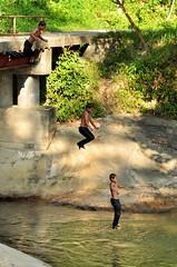 Jump Yo! (photo-razzo) Tags: bridge boy people face river asian jump nikon asia southeastasia child malaysia asean indigenous anak nationalgeographic orangasli d90 semai afsvrzoomnikkor70300mmf4556gifed asiatenggara discoveryphotos flickrtravelaward
