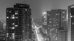 Long exposure 38/52 (Go-tea 郭天) Tags: canon bw bnw black white blackwhite blackandwhite monochrome asia asian china chinese shandong eos 100d 24mm prime 52 52project 38 long exposure skyline skycreapers buildings towers night cars light tall road busy windows citycenter avenue line straight