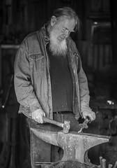 Calico Blacksmith (Jose Matutina) Tags: blackandwhite blacksmith caifornia calico civilwar reenactment reenactors sel85f14gm sonya7ii worker yermo