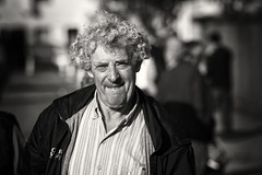 Curls (Frank Fullard) Tags: frankfullard fullard candid street portrait curls hair smile monochrome blackandwhite fair ballinasloe horsefair galway irish ireland beautifulbaby