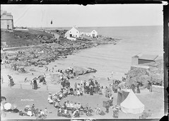 Punch and Judy? (National Library of Ireland on The Commons) Tags: ireland cliff beach dogs boats hotel rocks waves playa flags redensign tent violin northernireland fiddle buckets icehouse eason spades ulster portrush parasols antrim glassnegative sailorsuits sunshades bañarse seabankhotel strawboaters nationallibraryofireland bathingplace bathterrace easonson easoncollection limerickbybeachcomber portneen