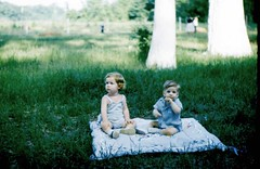 2 kids on a blanket in the grass (sundogrr) Tags: boy girl grass children outdoors toddler picnic fifties sister brother siblings 1950s blanket