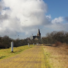Reformed church of Marken with dike along the Gouwsea (Bn) Tags: travel blue