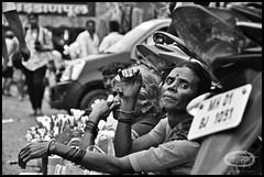 she's got the look ! (me&art) Tags: flowers woman india man kids lotus streetlife peoples maharashtra mumbai dadarflowermarket