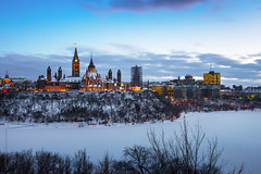 parliament hill in winter (tuanland) Tags: lighting winter sunset panorama ontario canada cold building ice festival architecture night festive evening twilight nikon cloudy ottawa wide parliament celebration bluehour parlement celebrate parliamenthill nightfall d600 nikond600 flickr10