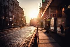 red head (ewitsoe) Tags: street city morning winter light people woman man sunshine architecture sunrise 35mm dawn lights march early streetlight cityscape crossing earlymorning poland sunny cobblestones oldtown earlyspring poznan jezyce nikond80 ewitsoe erikwitsoe