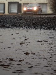 Rainy Tax Day Vignette (3/3) (Thiophene_Guy) Tags: car rain puddle headlights splash raindrop lowperspective originalworks groundperspective floorperspective thiopheneguy stylus790sw 790sw olympus790sw apr2014