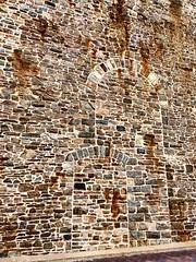 Doorway memories (Lady Goshen) Tags: stone wall rust ghost stonewall rememberwhen flickrfriday doorframes ghostoutlines ghostdoorframe