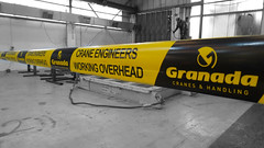Granada Cranes Men Working Overhead Barrier Tape