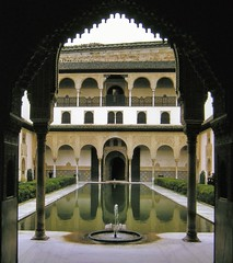 Court of the Myrtles, Alhambra Palace, 13thC, Granada, Andalusia, España (edk7) Tags: nikonnikkormatft kodachrome film slide edk7 1969 19691130 españa andalusia spain granada alhambra alhambrapalace nasriddynasty13thc patiodearrayanes courtofthemyrtles horseshoearch arch doorway moorish unescoworldheritagesite architecture building oldstructure sculpture stonecarving column capital fountain pool hedge colonnade reflection balcony railing filigree