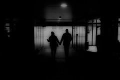 (formwandlah) Tags: kaiserslautern sunny day winter street photography streetphotography silhouette silhouettes silhouetten shadow schatten dark noir urban candid city strange gloomy cold sureal bizarr skurril abstract abstrakt melancholic melancholisch darkness light bw blackwhite black white sw monochrom high contrast ricoh gr pentax formwandlah thorsten prinz licht shadows fear paranoia einfarbig schwarzer hintergrund nacht fotorahmen spiegelung reflection reflektion schärfentiefe bürgersteig landstrase personen framed gasse architektur outdoor love couple passage holding hands