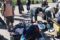 Looking through the clothes at a free giveaway in downtown Denver, sponsored by two area churches. The Inspire Church and Refuge Church host the event once a month at Civic Center Park. (desrowVISUALS.com) Tags: poverty poorpeople austerity hardtimes charity needy service freeclothing clothinggivaway theinspirechurch therefugechurch