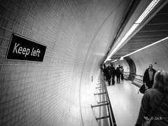 Keep left [On Explore] (Jack from Paris) Tags: street uk people lines  angle mtro curves tube wide corridor panasonic capture f28 couloir lignes gauche lightroom garder courbes nx2 conserver dmcgf1 pancake14mmf25asph p1020717bw