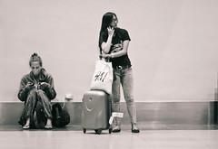 Airport Scenes (315Edith) Tags: ladies monochrome fun waiting philippines corridor 85mm passengers lane manila terminal3 phones naia passageway 500d domesticairport airportscene shootingstories