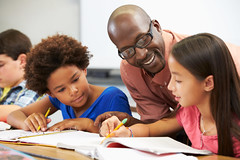 (smart_grades) Tags: school boy man black male men girl horizontal writing children asian book thirties student education sitting child classroom desk unitedstatesofamerica working class teacher professional together learning africanamerican teaching schoolchildren studying pupil elementary textbook 30s helping tutor occupation fourpeople concentrating 10yearold interactivewhiteboard encouraging 11yearold flickrandroidapp:filter=none