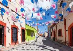 Overhead Flags _9301 (hkoons) Tags: street cars mexico town decoration streetscene flags historic mining sanluispotosi charcas