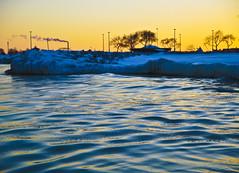 Ice Water Ripples On Lake Michigan (Light Brigading) Tags: trees sun mist snow vortex cold ice water wisconsin clouds frozen rocks downtown waves freezing down snap lakemichigan arctic milwaukee polar blast drifting subzero temperatures