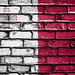 National Flag of Malta on a Brick Wall