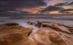 La Jolla Sea Sunset (tobyharriman) Tags: pictures ocean california light sunset seascape beach canon photography coast rocks sandiego cloudy cove scenic lajolla lee cracks southerncalifornia ndfilters induro waterstreaks tobyharriman