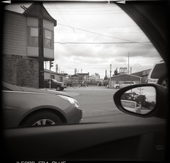 Whiting, IN (moominsean) Tags: film holga industrial driving toycamera indiana plastic pizza bp ilford fp4 whiting 120sf