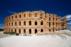 Colosseum of El Djem (Philipp Klinger Photography) Tags: africa blue light shadow sky sun rome architecture stairs nikon ruins shadows angle roman northafrica tunisia north wide amphitheatre ruin arc wideangle arches el colosseum afrika jem amphitheater northern v1 tunisie eljem tunesien kolosseum djem northernafrica eldjem mahdia  nordafrika    nikon1v1
