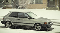 PA270005 (_KPGRAFIX) Tags: winter snow grey bucket rust wheels rusty chillin rustbucket 1992 mazda icicles hatchback beater rota 2door mazda323 2dr wetsnow winterbeater rotawheels 16x7
