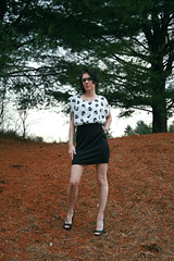 Amber (Melissa O'Donohue) Tags: trees red blackandwhite bw cold green nature girl beautiful forest skulls skinny outside glasses model woods pretty dress legs girly country pale tattoos pineneedles pines tiny heels upstatenewyork pinetrees girlswithtattoos