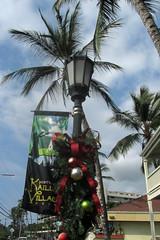 holiday lamp post (BarryFackler) Tags: lighting christmas light sky clouds palms hawaii polynesia streetlight banner palmtrees lamppost christmasballs tropical christmasdecoration ribbon bigisland kona christmasornaments kailuakona 2014 konacoast hawaiicounty aliidrive hawaiiisland northkona barryfackler barronfackler historickailuavillage