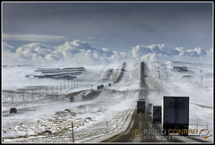 Wyoming-Interstate-01 (Pablo Conrad Photography) Tags: travel winter usa snow ice landscape accident snowy rocky blowing semi formation vehicle wa interstate wyoming icy hazardous wy tractortrailer wyo sheetice