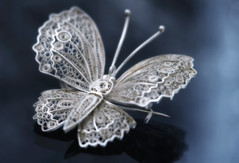 Filigree (Anne Worner) Tags: madeofmetal 925silver anneworner colorefex d7000 lensbaby nikon peruvian velvet56 antique brooch butterfly closeup delicate eagle filigree handmade intricate macro pin shiny silver f20 niksoftware metal