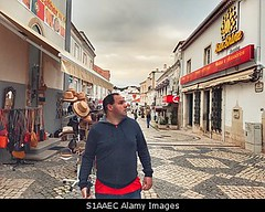 Photo accepted by Stockimo (vanya.bovajo) Tags: stockimo iphonegraphy iphone albufeira tourist shopping market street city town center urban man tourists shop shops walking alone