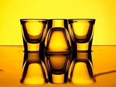 Shot Glasses (Karen_Chappell) Tags: orange yellow black glass glasses stilllife shotglasses shotglass three 3 reflection liquid water reflections abstract