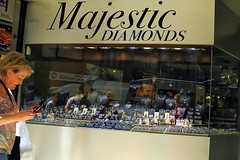 majestic diamonds (omoo) Tags: newyorkcity woman window glass self diamonds silver reflections gold store manhattan cellphone streetscene jewelry midtown majestic metals necklaces diamonddistrict diamondrings engagementrings reflectioms dscn3724 baublesandbangles majesticdiamonds west47thstreetbetween5thand6thavenues