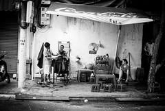 Life in Hanoi, Vietnam (Nathan O'Nions) Tags: life lighting street city people blackandwhite white haircut black male slr film look portraits 35mm canon hair mirror asia mood ae1 cut streetphotography clarity style vietnam barber hairdresser fujifilm canonae1 hanoi negatives ae1program filmphotography streetbarber filmnegatives moodu