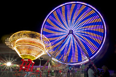 Guilford Fair rides (Bob Gundersen) Tags: park longexposure blue red orange usa white yellow blackbackground night catchycolors landscape outside photo interesting nikon flickr image shots outdoor connecticut shoreline picture newengland ct places ufo nightshots scenes gundersen guilford conn nikoncamera d600 guilfordfair nikond600 connecticutscenes bobgundersen robertgundersen