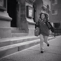In A Hurry (Joel Levin Photography) Tags: street portrait urban blackandwhite bw usa philadelphia square candid streetphotography squareformat philly runner allrightsreserved iphone mobilephotography thedefiningtouch iphoneography deftouch editedanduploadedoniphone ©joellevin definingtouchgroup