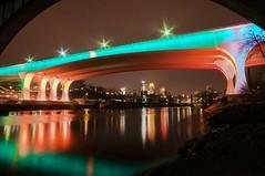 St.Patty's Reflections (Doug Wallick) Tags: bridge reflection minnesota skyline river mississippi day wide minneapolis stpatricks 35w lightroom a55 1oth