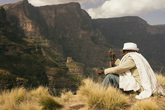Mountain Security (departing(YYZ)) Tags: africa old travel portrait people man mountains male hat outside outdoors nationalpark gun sitting watching guard weapon daytime ethiopia ak47 simienmountains sonnartfe35mmf28za