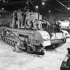 "ATS working on a Churchill tank at a Royal Army Ordnance Corps Depot • <a style=""font-size:0.8em;"" href=""http://www.flickr.com/photos/81723459@N04/19227834041/"" target=""_blank"">View on Flickr</a>"