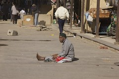 Beggar in the middle of a street (Ren Mouton) Tags: poverty man arm egypt beggar aswan egypte  straat asuan armoede  bedelen  syene mir assoean  swentet