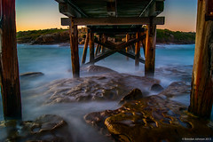 Under the Bridge (BrendanJ711) Tags: ocean longexposure bridge sea mist motion rocks waves sony sydney logs australia wharf nsw slowshutter alpha botanybay a390 laparouse