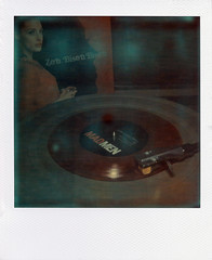 Mad Men Music (Brock5604) Tags: show red music playing classic film girl television french polaroid sx70 tv 60s experimental song vinyl megan indoor turntable cover single singer actress record land yamaha instant theme colored series amc rjd2 impossible draper madmen 7inch jessicapar gatefold px70 zoubisoubisou