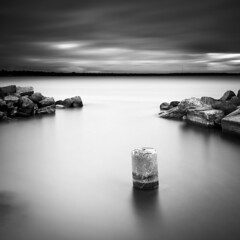 Rocks & concrete (- David Olsson -) Tags: longexposure morning sea blackandwhite bw seascape water monochrome june clouds square landscape concrete mono early nikon gate cloudy sweden harbour outdoor le opening grayscale gotland fx passage grad squarecrop vr fårö östersjön d800 1635 fishingharbour ndfilter blackglass 1635mm gnd sudersand smoothwater smoothsky 2013 leefilters concretefeet lenr bigstopper davidolsson 06hard 1635vr